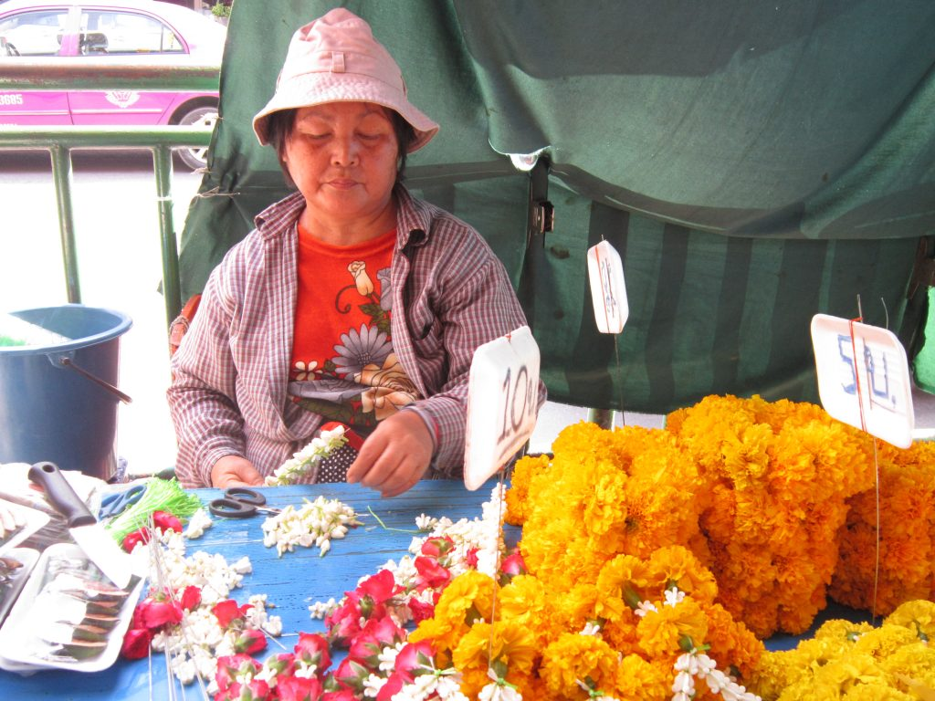 Thai lady selling flowers