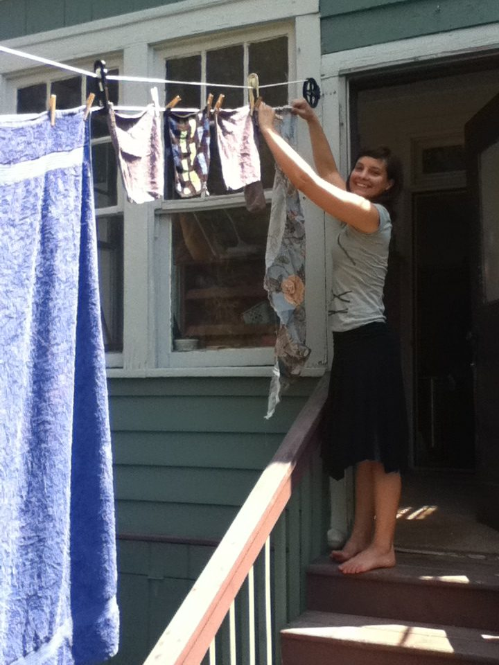 lady hanging laundry to dry